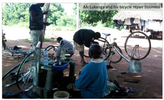 Mr Lukanga and his bicycle repair business